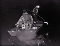 Some Ojibwe, such as these men at Mille Lacs Lake in 1998, use motorboats and headlamps to sustain tribal spear fishing traditions and defend treaty-guaranteed fishing rights. | Photo by Charles Rasmussen, courtesy of the Great Lakes Indian Fish and Wildlife Commission