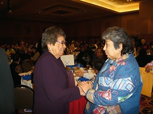 The late Mille Lacs Band of Ojibwe Chief Executive Marge Anderson (left) greets a band member at a tribal function. Under her leadership, the band built new schools, health clinics, community centers, housing, a water treatment plant, and other infrastructure. | Courtesy of the Mille Lacs Band of Ojibwe