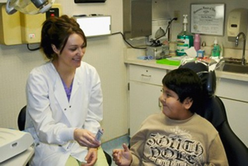 A young member of the Mille Lacs Band of Ojibwe smiles during a dental screening at one of the band's three health clinics.| Courtesy of the Mille Lacs Band of Ojibwe
