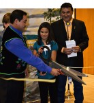 Bois Forte Tribal Chair Kevin Leecy; District I Representative Cathy Chavers (partially hidden);  Kristen Lilya, sixth-grader and student council president at the Nett Lake School; and tribal Secretary-Treasurer David Morrison at a ribbon-cutting ceremony for the new Bois Forte government and community services center in Nett Lake, 2010. | Photo by Jeff Henningsgaard, courtesy of the Bois Forte Band of Chippewa