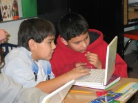 John Whiteman (left) and Parker Drift conduct research in their classroom at the Nett Lake School, Bois Forte Reservation, 2009. The computers were donated by the Fortune Bay Resort Casino, which is owned and operated by the Bois Forte Band. | Photo by Helen Wilkie, courtesy of the Bois Forte Band of Chippewa